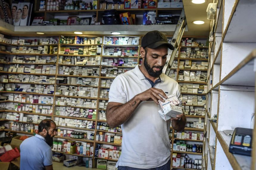 Pharmacist Masroor Nazir checks his stock of a medicine at his shop in Srinagar, Kashmir, on Aug 11, 2019.