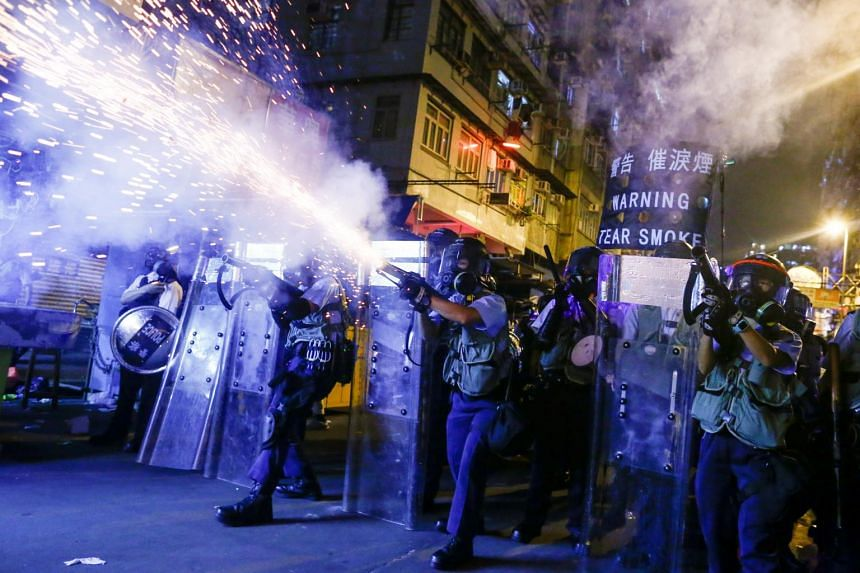 Police fire tear gas at anti-extradition bill protesters during clashes in Sham Shui Po in Hong Kong on Aug 14, 2019.