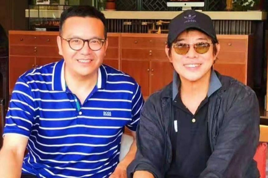 One photo, taken with a fan, showed Li (right), 56, in a good mood as he smiled broadly for the camera.