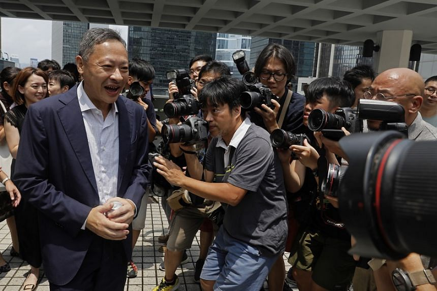 Benny Tai (left) was sentenced to 16 months' jail as one of nine leaders of a 2014 drive for universal suffrage known as the Umbrella Movement.