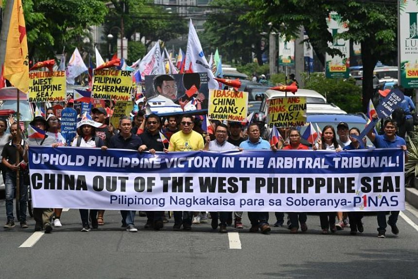 Protesters marching towards the Chinese consulate for a rally in Manila on July 13, 2019, to coincide with the anniversarry of an arbitral ruling by the United Nations on the South China Sea.