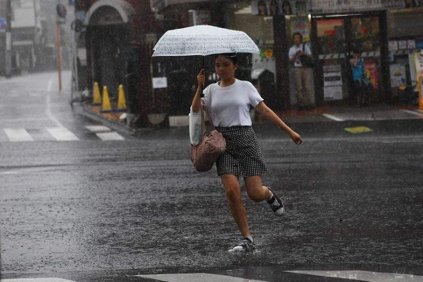 Heavy rain in Tokyo on Aug 15, 2019, the same day a severe tropical storm slammed into Japan's south, bringing strong winds and torrential rain that claimed at least one life.