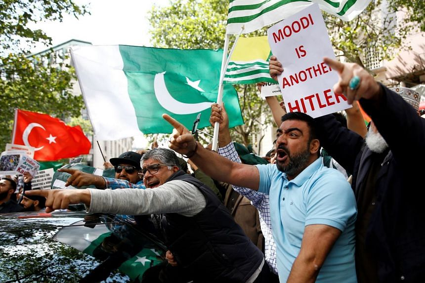 Demonstrators protest against the scrapping of the special constitutional status in Kashmir.
