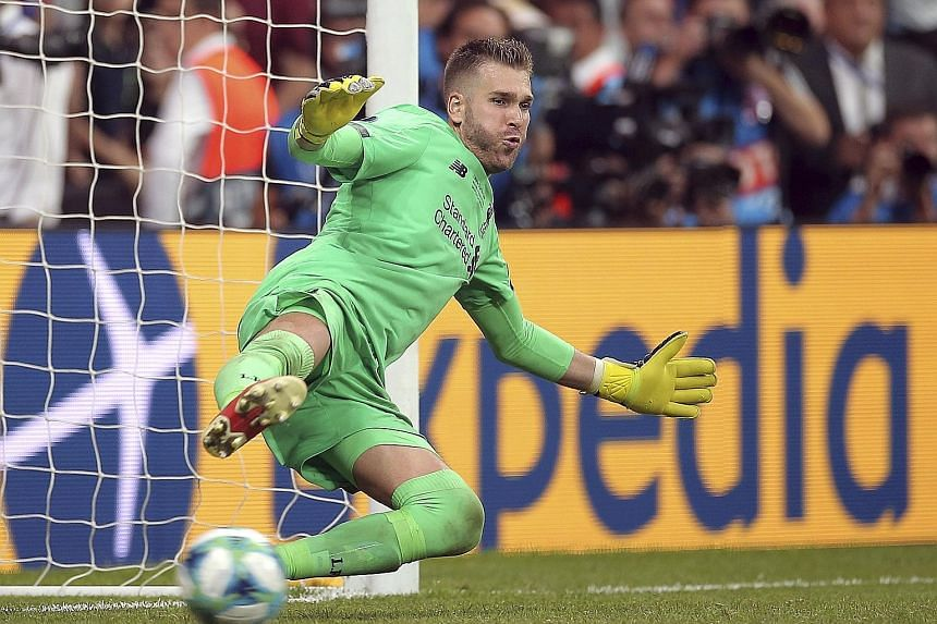 Left: Liverpool goalkeeper Adrian is the toast of his teammates after his save sealed a 5-4 penalty shoot-out win over Chelsea in the Uefa Super Cup match. It ended 2-2 in extra time on Wednesday. PHOTO: DPA Below: Adrian, who spent the bulk of last