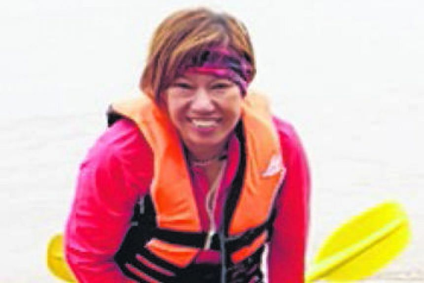 Above: Madam Puah Geok Tin's body was found on Wednesday by a fisherman off the coast of Kemaman, Terengganu. Right: Madam Kwan Yoke Yee, 58, the wife of missing kayaker Tan Eng Soon, and Madam Puah's son Louis Pang coming out of a room at Penyabong