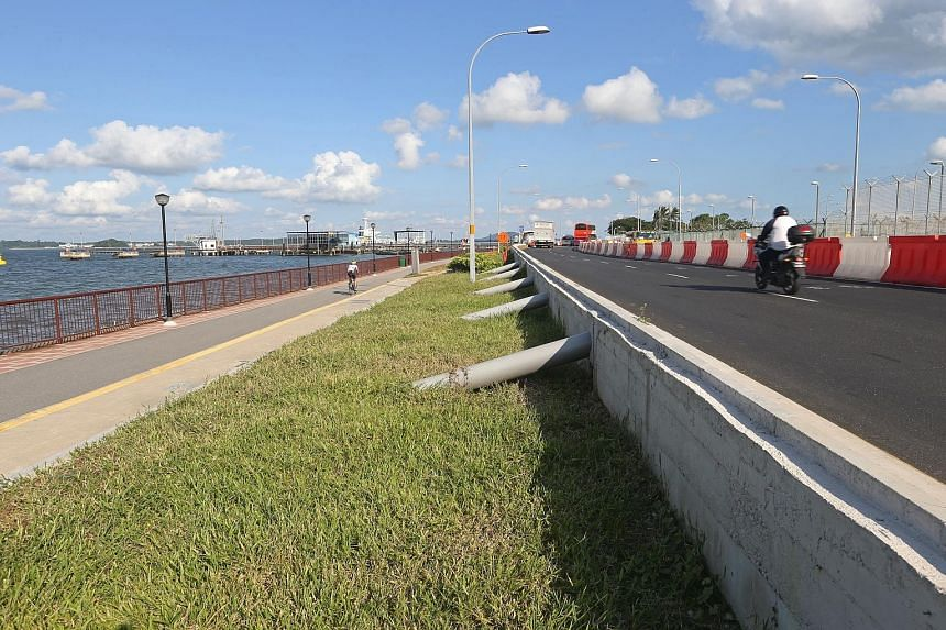 In this file photo from 2016, a stretch of Nicoll Drive, next to Changi Beach, is shown freshly elevated to prepare for rising sea levels due to climate change.