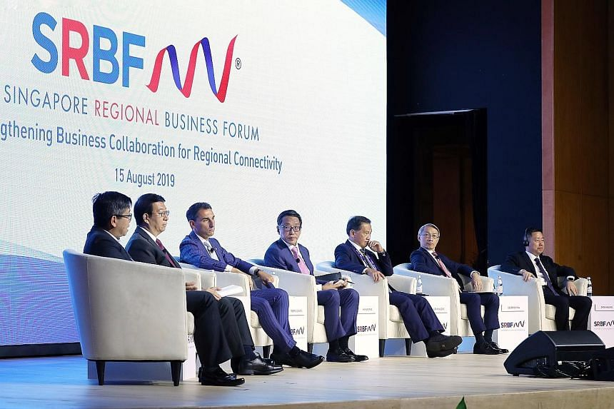 Banyan Tree Holdings executive chairman Ho Kwon Ping (centre) moderating the plenary session of the Singapore Regional Business Forum yesterday, with the panel comprising (from left) GIC managing director Boon Chin Hau, China International Capital Co