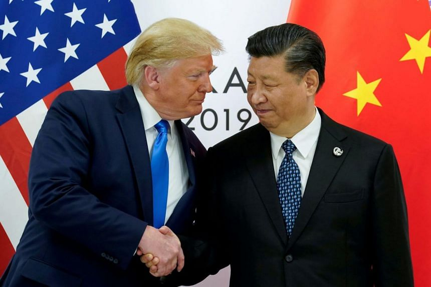"""US President Donald Trump (left) tweeted that Chinese President Xi Jinping should be """"humane"""" in dealing with protesters in Hong Kong."""