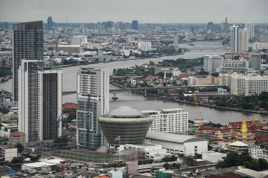 Buildings and temples along the Chao Praya River in Bangkok, on Aug 6, 2019.