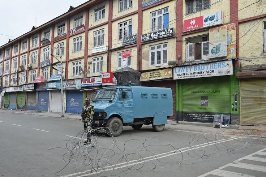 A member of the Indian security forces stands guard during a lockdown in Srinagar, on Aug 16, 2019, after the Indian government stripped Jammu and Kashmir of its autonomy.