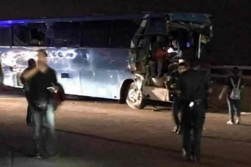 The Malaysia-registered bus that was involved in the fatal accident on a ramp near the arrival hall of Tuas Checkpoint on Feb 26, 2019.
