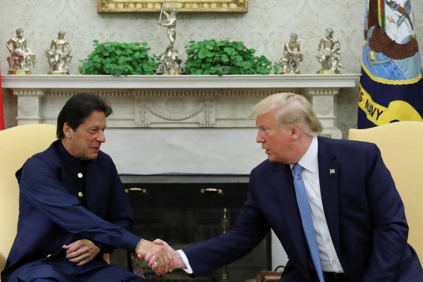 In this photo taken on July 22, 2019, US President Donald Trump greets Pakistan's Prime Minister Imran Khan in the Oval Office at the White House in Washington.