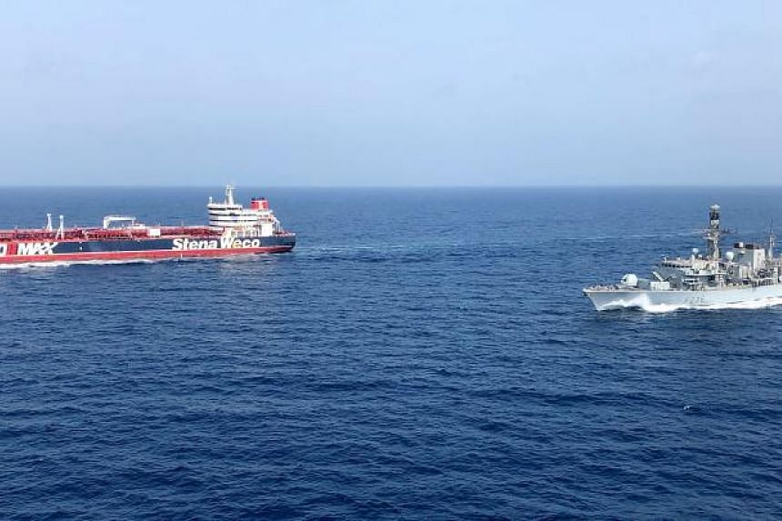 The HMS Montrose (right) accompanying the Stena Important vessel in the Gulf on July 25, 2019.