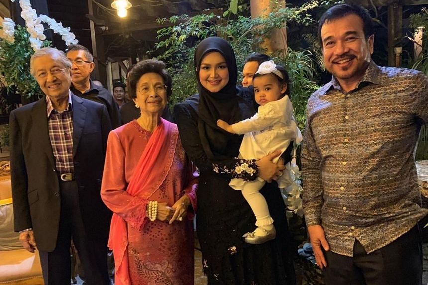 Siti Nurhaliza, her husband and their daughter with Malaysian Prime Minister Mahathir Mohamad and his wife, Dr Siti Hasmah Mohd Ali, at the celebration.