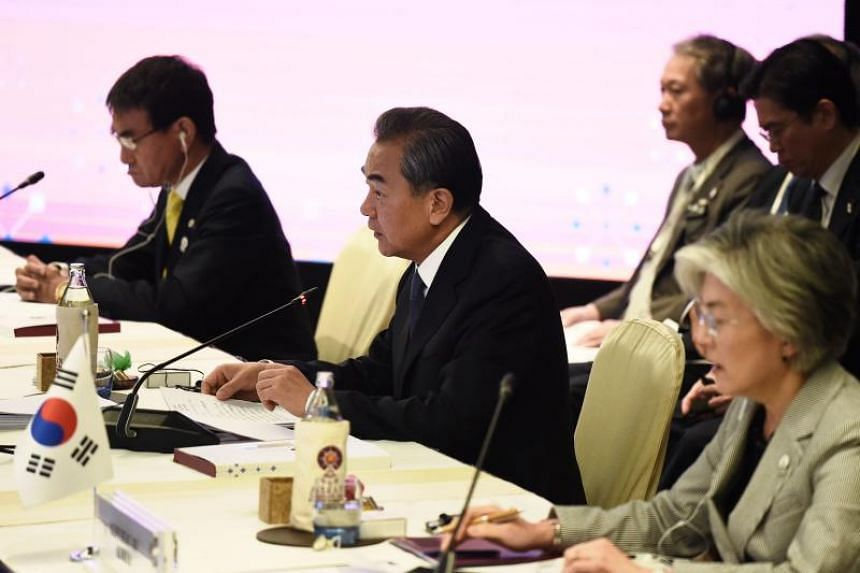 (From left) Japan's Foreign Minister Taro Kono, China's Foreign Minister Wang Yi and South Korea's Foreign Minister Kang Kyung-wha during the Asean Plus Three meeting in Bangkok on Aug 2, 2019.