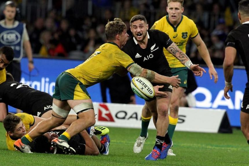 Australia's captain Michael Hooper (left) tackles New Zealand's T J Perenara during the Rugby Championship Bledisloe Cup Test match between the Australian Wallabies and New Zealand All Blacks.