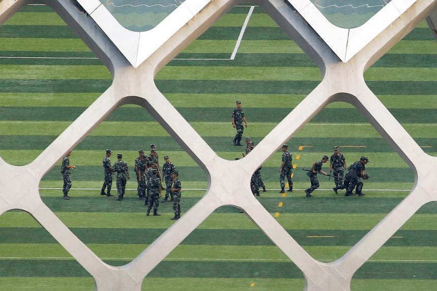 In a photo taken on Aug 15, 2019, Chinese soldiers practice detaining a person on the grounds of the Shenzhen Bay Sports Centre in Shenzhen, China, across the bay from Hong Kong.