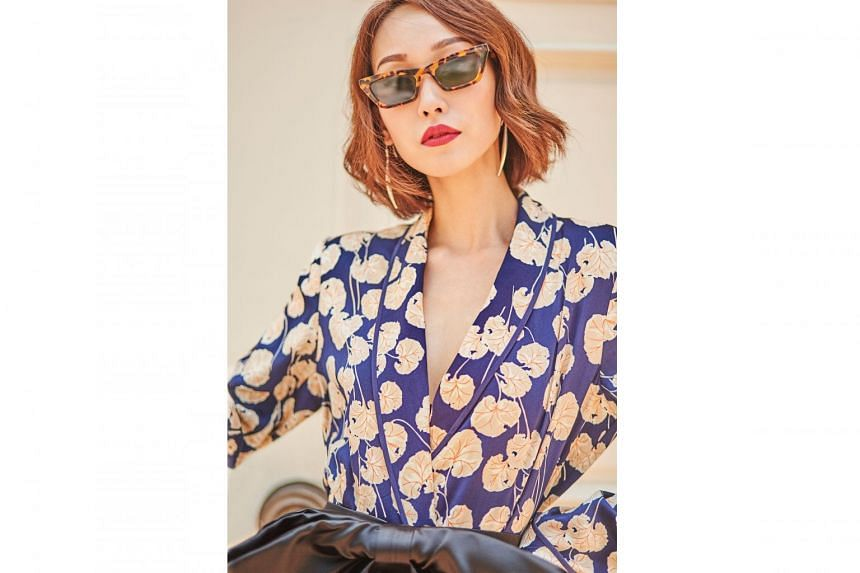 Pyjama-inspired florals get the daytime treatment when worn with statement accessories. Sunglasses, $300, from Gentle Monster; earrings, $265, from Tory Burch; jacket (worn as top), $800, from Diane von Furstenberg; Kimhekim belt, $679, from Society