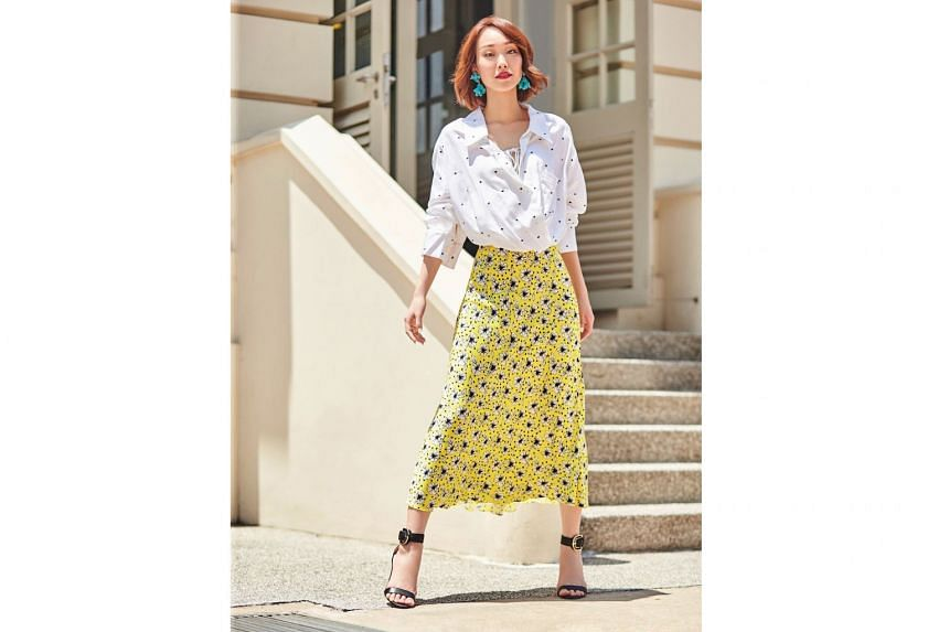 Go two-for-two and pair a dotted blouse with a vintage-inspired slip skirt. Dinosaur Designs earrings, $225, and Jacquemus top, $766, both from Net-a-Porter; skirt, $69.90, from Zara; shoes, $85.90, from Charles & Keith.