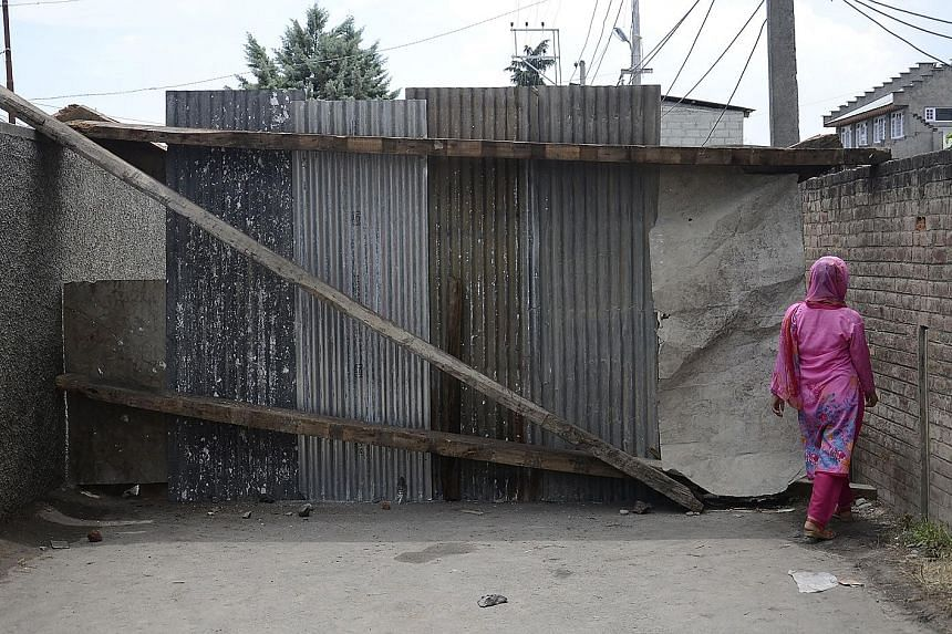 A barrier on a blocked road in the main Kashmir city of Srinagar in India, amid restrictions on movement of people and communications. India's Supreme Court has deferred a case calling on the Modi government to lift curbs in Kashmir that have been in