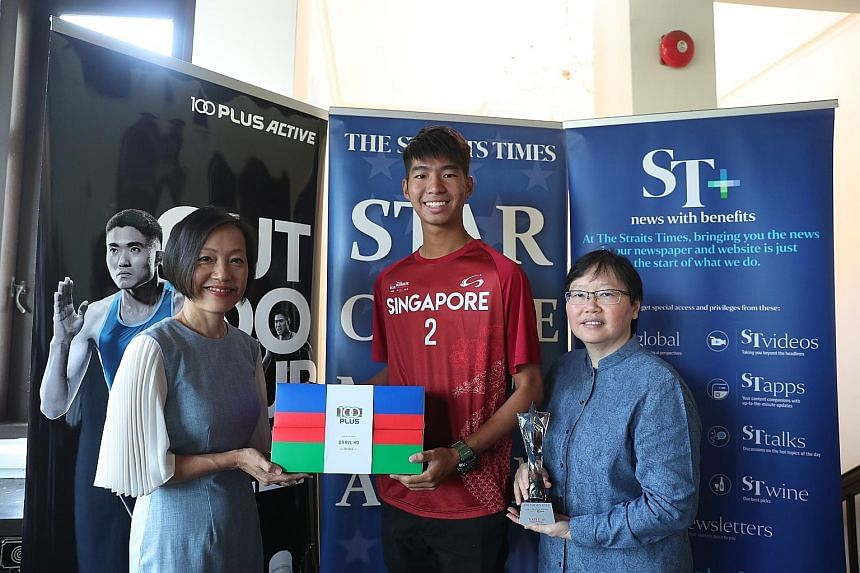 July's ST Star of the Month winner Daryl Ho receiving his award from Jennifer See (left), managing director F&N Foods Pte Ltd, and Lee Yulin, ST sports editor. The 1.87m standout helped Singapore edge out Latvia 15-12 in the bronze play-off to earn a hist