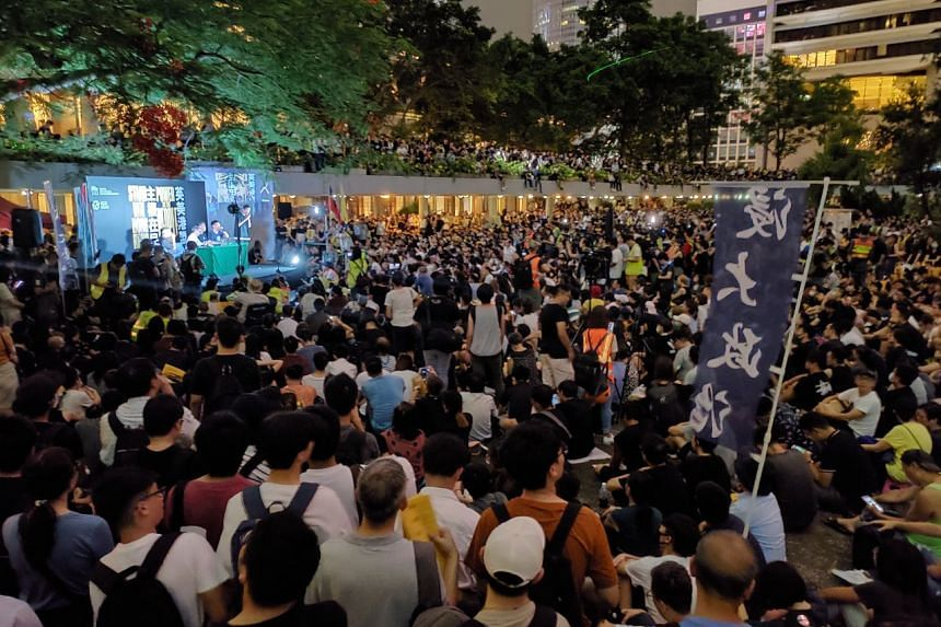 Thousands gather at Chater Park in downtown Hong Kong for a rally calling on the US and the UK to impose sanctions on Hong Kong officials who they said have suppressed rights and freedoms in the territory.