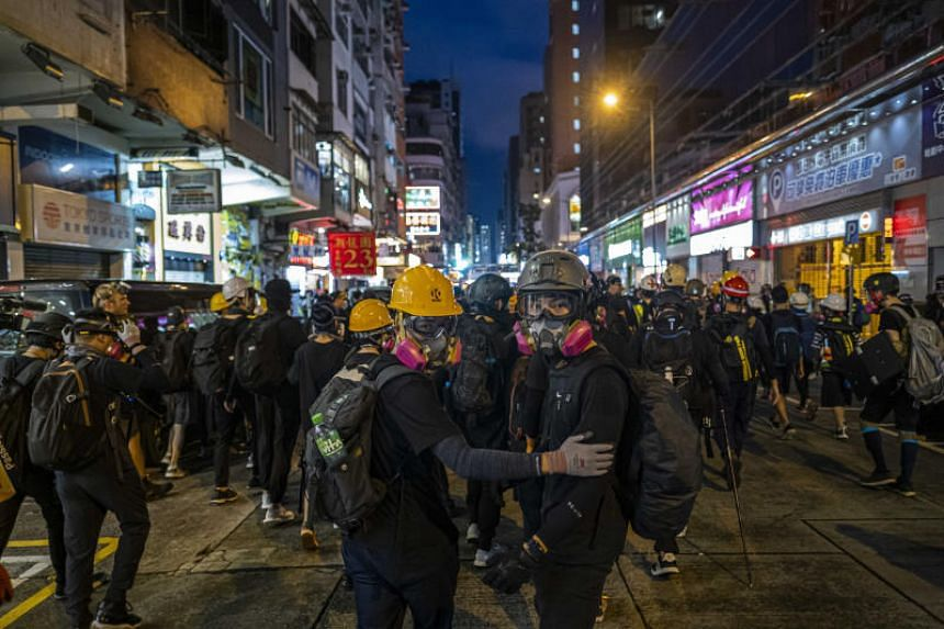 Demonstrators near a police station in the Mong Kok district of Hong Kong, after a march in the residential district of Hung Hom, on Aug 17, 2019.