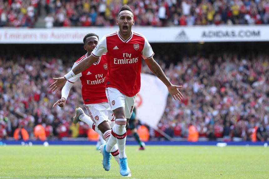 Arsenal's Pierre-Emerick Aubameyang celebrates scoring his side's second goal with teammates during the English Premier League soccer match between Arsenal and Burnley at The Emirates Stadium on Aug 17, 2019.