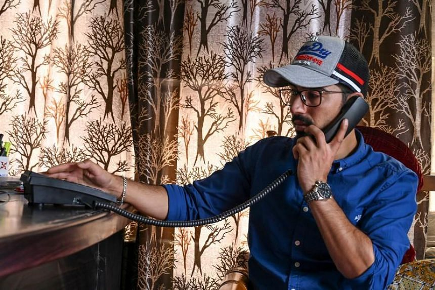 A Kashmiri talks on a landline phone in Srinagar on Aug 17, 2019. New Delhi cut landlines, mobile phones and the internet in early August as it stripped the Muslim-majority region of its autonomy.