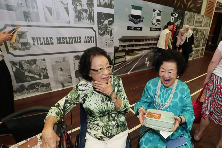 Mrs Ivy Kwa (left), 93, and Mrs Betty Chen, 92, both from the class of 1941, return to Anderson Road for a Raffles Girls' School alumni event.