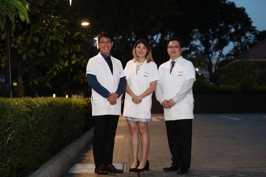 Freshmen from Duke-NUS Medical School's Doctor of Medicine programme, (from left) Eric Tay, Lisabel Ting and Lim Chun Chai.