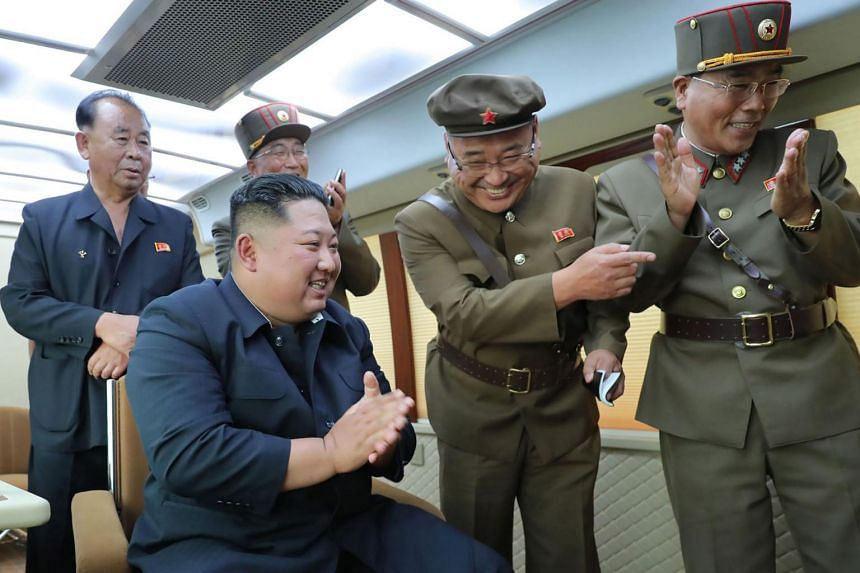 In this picture released on Aug 17, 2019, by North Korea's official Korean Central News Agency, Korean leader Kim Jong-Un (seated) is seen celebrating the successful test-firing of a new weapon, presumed to be two short-range ballistic missiles, at a