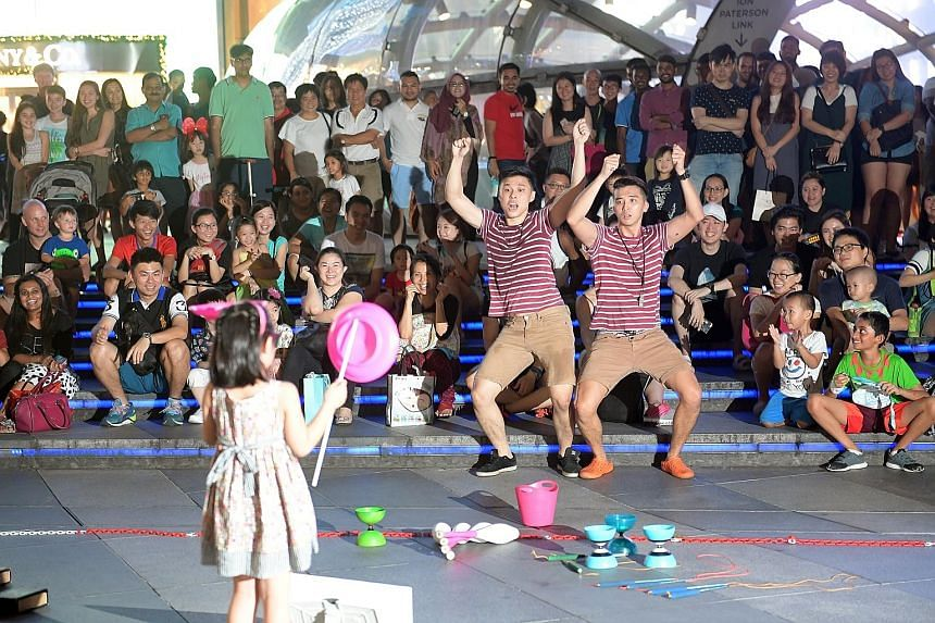 In this photo taken in 2016, Jonathan Goh (far left) and Edwin Ong pair up as The Annoying Brothers to perform in Orchard Road.