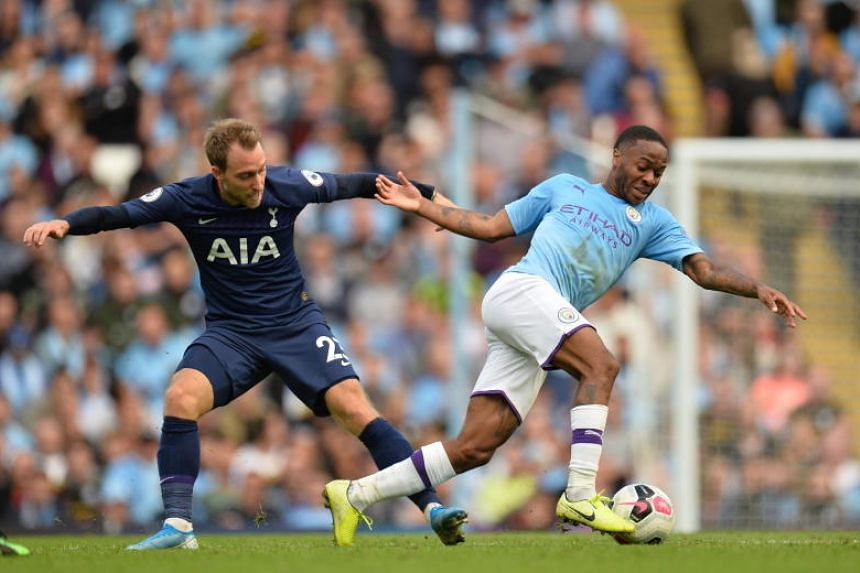 Manchester City's Raheem Sterling (right) in action against Tottenham Hotspur's Christian Eriksen during the English Premier League soccer match between Manchester City and Tottenham Hotspurs at the Etihad Stadium in Manchester, Britain, on Aug 17, 2