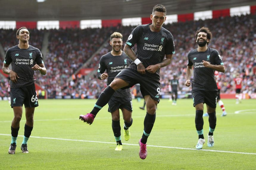 Liverpool's Roberto Firmino, centre, celebrates scoring his side's second goal of the game during the English Premier League soccer match between Southampton and Liverpool, at St Mary's, in Southampton, on  Aug 17, 2019.