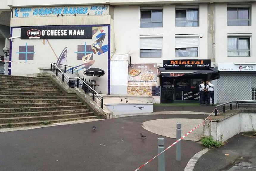 Policemen stand in front of the eatery where a waiter was shot dead by a customer allegedly angry at having to wait for a sandwich, in the eastern Paris suburb of Noisy-le-Grand on Aug 17, 2019.