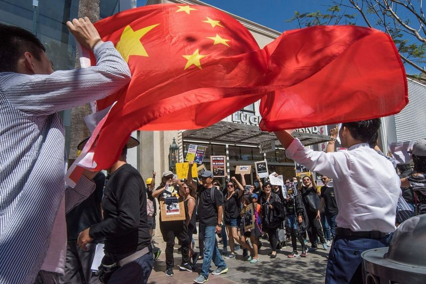 Chinese counter-protesters wave the Chinese flag as members of the US Hong Kong community protest against what they say is police brutality during the ongoing Hong Kong protests in Santa Monica, California on Aug 17, 2019.