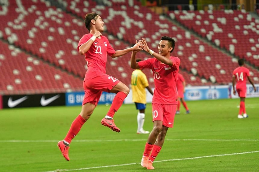 In a picture taken on June 8, 2019, Singapore's Gabriel Quak celebrates a goal with Faris Ramli against Solomon Islands in an international friendly at the National Stadium in Singapore.