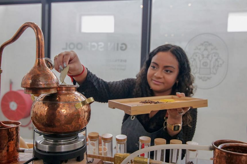 """Botanicals are tipped into the copper pot still, which is then sealed to wait for the """"heads"""", or the first cut of the alcoholic spirit, to come out from the tubes."""