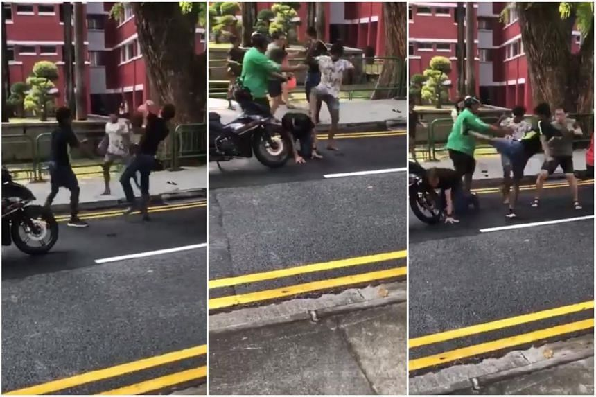 A video of the brawl making the rounds on Facebook shows two men shoving and hitting an older man, and passers-by, including a GrabFood delivery rider, trying to break up the fight.