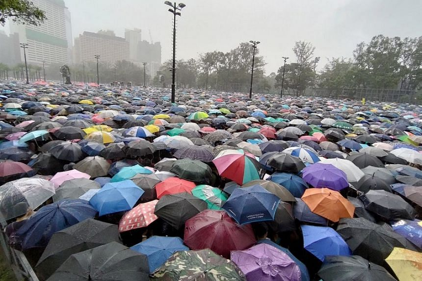 A heavy downpour fell on tens of thousands of people who turned up at Hong Kong's Victoria Park for a rally on Aug 18, 2019.