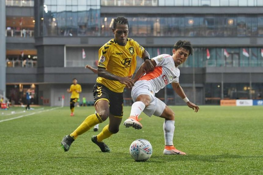 Hiroyoshi Kamata of Albirex Niigata tries to stop Jordan Webb of the Tampines Rovers during a Singapore Premier League match at Our Tampines Hub on Aug 18, 2019.