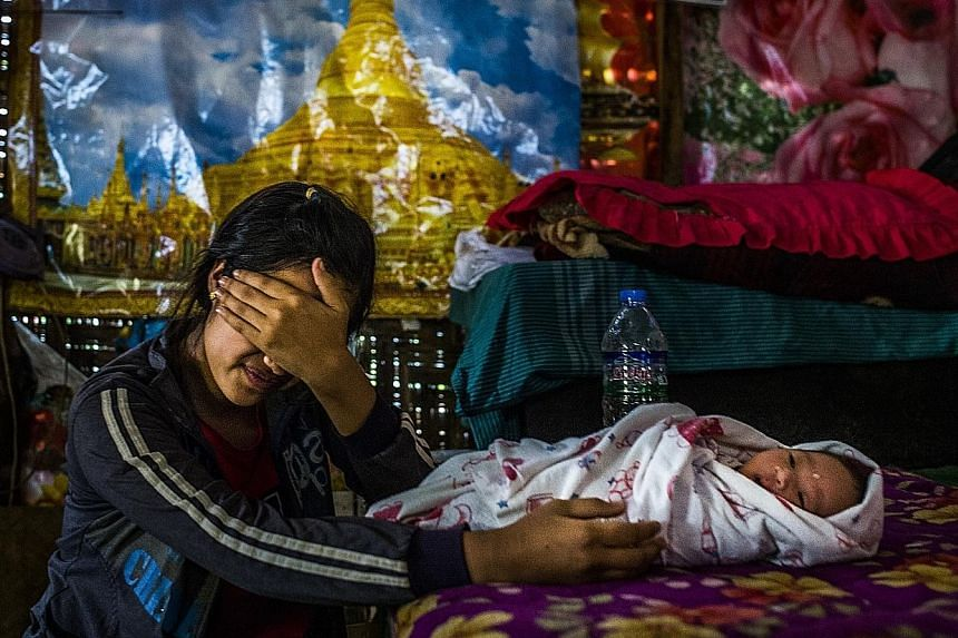 Above: Nyo, 17, on March 30 in Mong Yal, Myanmar, with the baby she had after she was sold to a man in Henan.