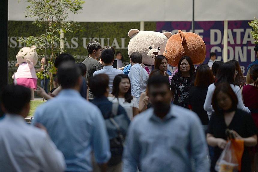 Life-size teddy bears at Raffles Place Park on Aug 1 as part of a campaign by Workforce Singapore to highlight programmes to help Singaporeans take on new jobs. Lower trade volumes and dampened demand from the US and China could impact Singapore firm