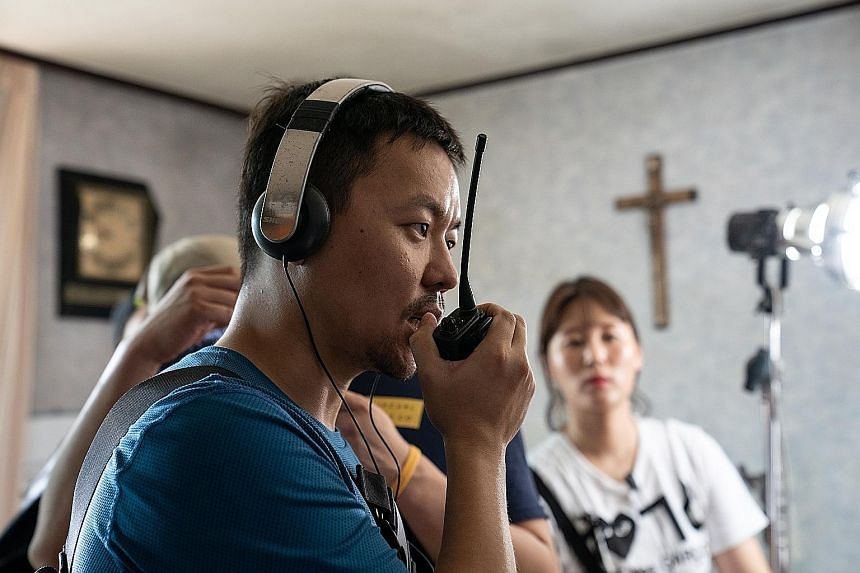 Directed by Kim Joo-hwan (left), The Divine Fury stars Ahn Sung-ki as a Catholic priest who performs exorcisms aided by a professional fighter played by Park Seo-joon (both above).