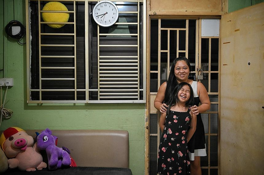Receptionist Rachel Hong and her daughter Faith, who received help from the Circle of Care programme, at their Lengkok Bahru rental flat. Ms Hong says she has seen the 10-year-old improve by leaps and bounds.