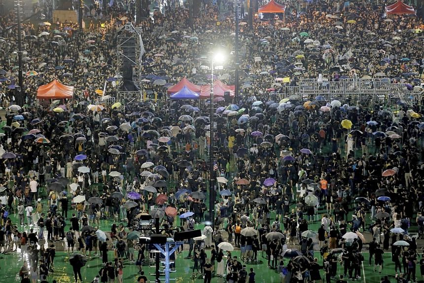 Hong Kong leader Carrie Lam hopes peaceful rally presages `return to calm`