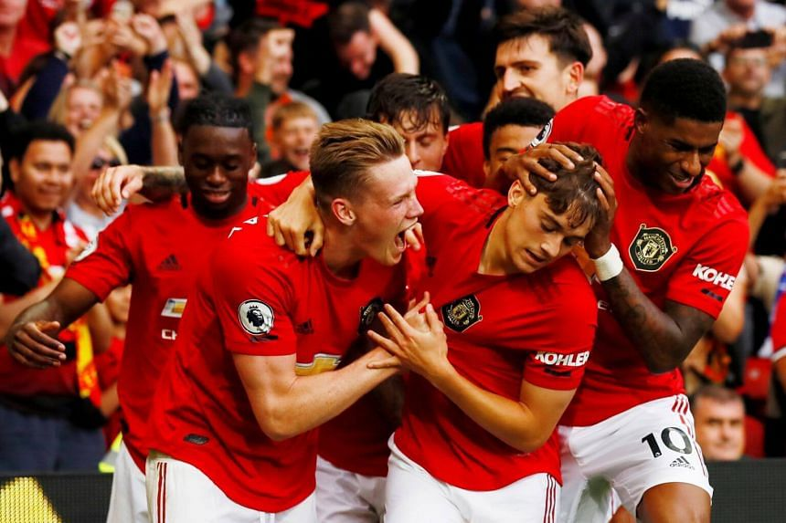 Manchester United's players celebrate after scoring a goal against Chelsea during their match at Old Trafford, on Aug 11, 2019.