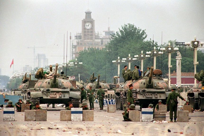 In this picture from June 6, 1989, People's Liberation Army (PLA) tanks and soldiers guard the strategic Chang'an Avenue leading to Tiananmen Square in Beijing two days after their crackdown on pro-democracy students.