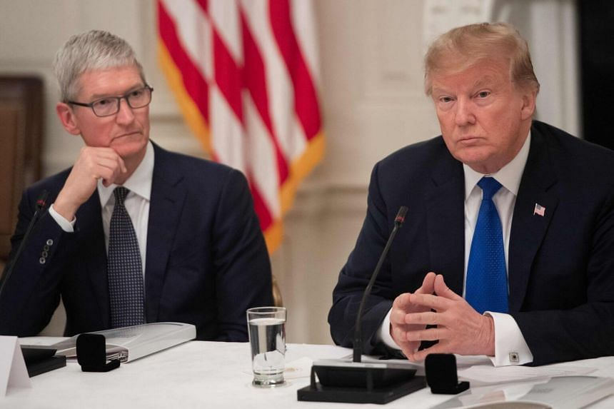 In a picture taken on March 6, 2019, President Donald Trump speaks alongside Apple CEO Tim Cook during the first meeting of the American Workforce Policy Advisory Board at the White House in Washington, DC.